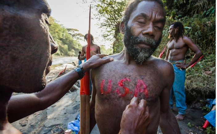 "Lamakara villagers paint USA on theirs chests and backs. For them the United States is a dream country, from where they except to receive ""cargo"", that was promised by John Frum."